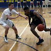 Lorain's Jalil Little drives past Scoti Millgard of North Ridgeville. Randy Meyers -- The Morning Journal