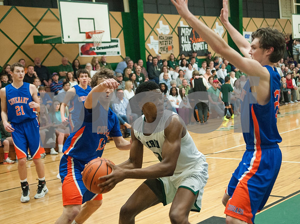 Bishop Thomas K. Gorman's Judah Bell tries to move past Colleyville Convenant's Cole Niles during their game Friday Feb. 19, 2016 at home. Gorman lost, 35-61.   (Sarah A. Miller/Tyler Morning Telegraph)