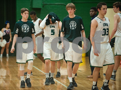 Bishop Thomas K. Gorman basketball players walk back to their bench after falling to Colleyville Convenant 35-61 at home Friday.   (Sarah A. Miller/Tyler Morning Telegraph)