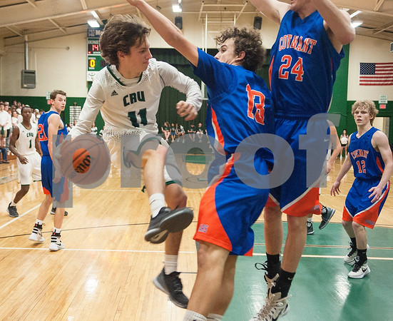 Bishop Thomas K. Gorman's (11) Nic Vandiver jumps as he tries to move the ball past Colleyville Convenant's (13) Daniel Turner and (24) Cole Niles during their game Friday Feb. 19, 2016 at home. Gorman lost, 35-61.   (Sarah A. Miller/Tyler Morning Telegraph)
