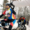 Record-Eagle/Keith King<br /> Jun Buison, of Livonia, takes some water handed out by a volunteer Saturday, November 6, 2010 during the 21st annual Iceman Cometh Challenge bicycle race.