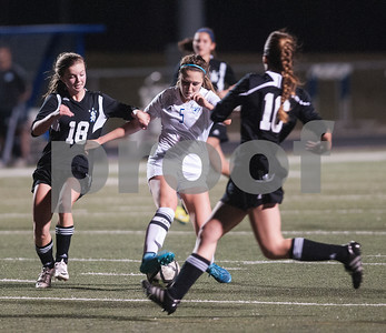 Grace Community School's Allie McCracken controls the ball as she's surrounded by All Saints defenders during their TAPPS D-II soccer regional final against All Saints Feb. 20, 2016 at Clyde-Perkins Stadium. Grace won, 1-0.  (Sarah A. Miller/Tyler Morning Telegraph)