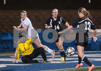 All Saints Episcopal School's (13) Samantha Morgan tries to score while Grace Community School's goalie Rylan Wright is down, but Wright saves the ball during their TAPPS D-II soccer regional final Feb. 20, 2016 at Clyde-Perkins Stadium. Grace won, 1-0.  (Sarah A. Miller/Tyler Morning Telegraph)