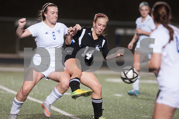 Grace Community School's Emily McKinney and All Saint's Allie Werner battle for the ball during their TAPPS D-II soccer regional final Feb. 20, 2016 at Clyde-Perkins Stadium. Grace won, 1-0.  (Sarah A. Miller/Tyler Morning Telegraph)