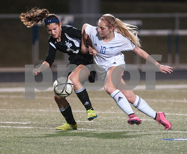All Saints Episcopal School's Emmy Hager and Grace Community School's Lexye Price compete in their TAPPS D-II soccer regional final Feb. 20, 2016 at Clyde-Perkins Stadium.  (Sarah A. Miller/Tyler Morning Telegraph)