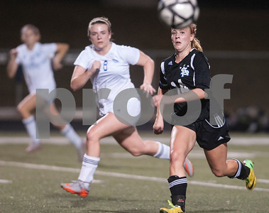 Grace Community School's Emily McKinney and All Saint's Allie Werner chase the ball during their TAPPS D-II soccer regional final Feb. 20, 2016 at Clyde-Perkins Stadium. Grace won, 1-0.  (Sarah A. Miller/Tyler Morning Telegraph)