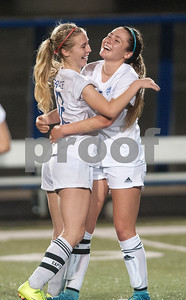 The Grace Community School's Sophie Claire Rook and Allie McCracken hug after winning their TAPPS D-II soccer regional final against rival All Saints Episcopal School Saturday Feb. 20, 2016 at Clyde-Perkins Stadium.  (Sarah A. Miller/Tyler Morning Telegraph)
