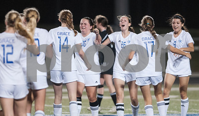 The Grace Community School girls soccer team reacts to winning their TAPPS D-II soccer regional final against rival All Saints Episcopal School Saturday Feb. 20, 2016 at Clyde-Perkins Stadium.  (Sarah A. Miller/Tyler Morning Telegraph)