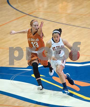 University of Texas at Tyler's Michelle Obach dribbles past University of Texas at Dallas' McKenzie Petty during their final regular season game at the Herrington Patriot Center Saturday Feb. 20, 2016. No. 5 UT-Tyler defeated UT-Dallas 88-69 making their record 15-0 in ASC East Division.  (Sarah A. Miller/Tyler Morning Telegraph)