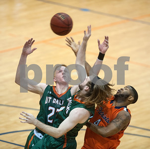 University of Texas at Tyler's Dyonne Luke moves the ball out of reach of University of Texas at Dallas' Ben Smith and Noah Hill at the Herrington Patriot Center Saturday Feb. 20, 2016.   (Sarah A. Miller/Tyler Morning Telegraph)