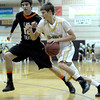 Monarch's Ben Beauchamp (right) dribbles past Lakewood's Guy Young during their basketball game at Monarch High School in Louisville, Colorado February 21, 2012. CAMERA/MARK LEFFINGWELL