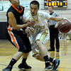 Monarch's Hank Yen (right) bumps Lakewood's Chris Page (left) during their basketball game at Monarch High School in Louisville, Colorado February 21, 2012. CAMERA/MARK LEFFINGWELL