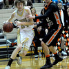 Monarch's Alex Krason (left) moves toward the basket while being guarded by Lakewood's Guy Young (right) during their basketball game at Monarch High School in Louisville, Colorado February 21, 2012. CAMERA/MARK LEFFINGWELL