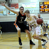 Monarch's Kyle Billingsley (right) takes the ball past Lakewood's Nermin Kozic (left) during their basketball game at Monarch High School in Louisville, Colorado February 21, 2012. CAMERA/MARK LEFFINGWELL