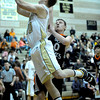 Monarch's Wes Moon (left) gets a shot past Lakewood's Irhad Kozic (right) during their basketball game at Monarch High School in Louisville, Colorado February 21, 2012. CAMERA/MARK LEFFINGWELL