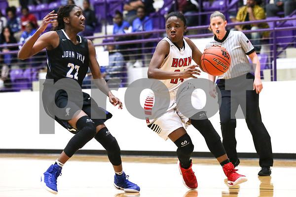 Dr. John Horn senior Raneisha Williams (24) dribbles the ball during a 6A region 2 quarterfinal game at Eustace High School in Eustace, Texas, on Tuesday, Feb. 21, 2017 (Chelsea Purgahn/Tyler Morning Telegraph)