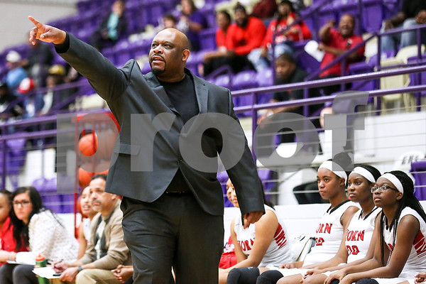 Dr. John Horn head coach Darrin Samuels points as he talks to his team on the court during a 6A region 2 quarterfinal game at Eustace High School in Eustace, Texas, on Tuesday, Feb. 21, 2017. The John Tyler Lady Lions beat the Dr. John Horn Jaguars 65-50. (Chelsea Purgahn/Tyler Morning Telegraph)