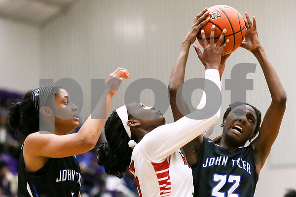 John Tyler senior Bre Staten's (22) shot is blocked by Dr. John Horn junior Tajuan Lewis (15) during a 6A region 2 quarterfinal game at Eustace High School in Eustace, Texas, on Tuesday, Feb. 21, 2017 (Chelsea Purgahn/Tyler Morning Telegraph)