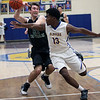 Javon Todd of Clearview strips the ball from Sean Szabo of Elyria Catholic during the first quarter. Randy Meyers -- The Morning Journal