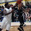 Clearview's DeAri Todd and Dorian Crutcher of Elyria Catholic battle for a rebound during the second quarter. Randy Meyers -- The Morning Journal