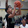 Jarred Logan of Elyria Catholic shoots over Sam Daniels of Clearview during the first quarter. Randy Meyers -- The Morning Journal