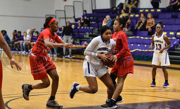 CaLeyah Burrell (5) of Jacksonville College pushes between Trinity Valley defenders Jasmine Smith (23), left and Tra'dayja Smith (14), right during a game on Saturday, February 2. (Jessica T. Payne/Tyler Morning Telegraph)