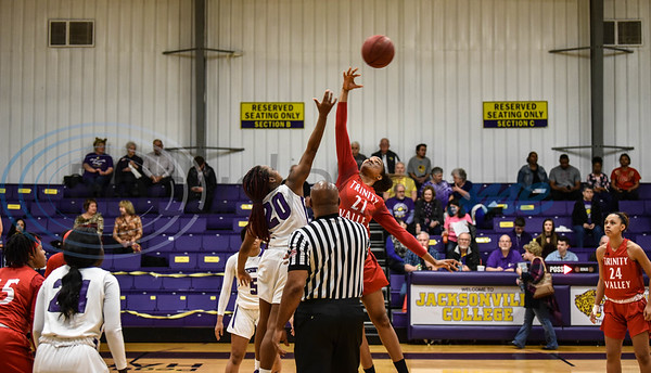Jacksonville College's Alexis Wheeler (20) and Trinity Valley's Solmilena Herrera (21) jump for the ball during tip off on Saturday, February 2. The two teams battled it out during Jacksonville College's homecoming night at home. (Jessica T. Payne/Tyler Morning Telegraph)