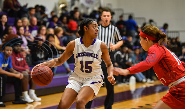 Na'Kendra Ellis (15) of Jacksonville College looks behind to pass during a game played on Saturday, February 2. The game against Trinity Valley was played in Jacksonville on homecoming night with the King and Queen being announced during halftime. (Jessica T. Payne/Tyler Morning Telegraph)