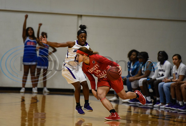 Trinity Valley Sophomore Tayton Hopkins (10) attempts go around Jacksonville College Freshman Tamaria Manning (13). The teams battled it out on Saturday, February 2 during Jacksonville College's homecoming night. (Jessica T. Payne/Tyler Morning Telegraph)