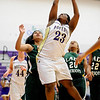 Boulder's Ashley Kennedy (right) gets a shot over Washington's Kalita Taie (left) during their basketball game at Boulder High School in Boulder, Colorado February 22, 2011.  CAMERA/Mark Leffingwell