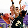 Boulder's Ande Lampert (left) collides with Washington's Valencia Watson (left) during their basketball game at Boulder High School in Boulder, Colorado February 22, 2011.  CAMERA/Mark Leffingwell