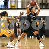 Panola College sophomore Denasia Watson (12) prepares to pass the ball during a Region XIV college basketball game at Tyler Junior College in Tyler, Texas, on Wednesday, Feb. 22, 2017. The Panel College Ponies beat the Tyler Junior College Apaches 75-70. (Chelsea Purgahn/Tyler Morning Telegraph)