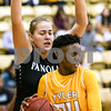 Tyler Junior College Sky'lynn Holmes (24) is blocked by Panola College freshman Daria Eremeeva (2) during a Region XIV college basketball game at Tyler Junior College in Tyler, Texas, on Wednesday, Feb. 22, 2017. The Panel College Ponies beat the Tyler Junior College Apaches 75-70. (Chelsea Purgahn/Tyler Morning Telegraph)