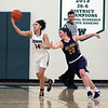 Westlake's Abby Carrington grabs a rebound away from Clare Kelly of Olmsted Falls during the second quarter. Randy Meyers -- The Morning Journal