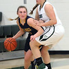 Olmsted Falls guard Danielle Stevens drives around Angela Campo of Westlake during the third quarter. Randy Meyers -- The Morning Journal