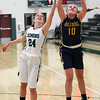 Danielle Stevens of Olmsted Falls grabs a rebound away from Katarina Jamsek of Westlake during the first quarter. Randy Meyers -- The Morning Journal
