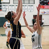 Chloe Akins of Olmsted Falls shoots and scores over Katarina Jamsek of Westlake during the second quarter. Randy Meyers -- The Morning Journal