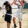 Westlake's Madi Mulder shoots over Chloe Akins of Olmsted Falls during the third quarter. Randy Meyers -- The Morning Journal