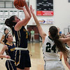 Clare Kelly of Olmsted Falls shoots and scores over Katarina Jamsek of Westlake during the second quarter. Randy Meyers -- The Morning Journal