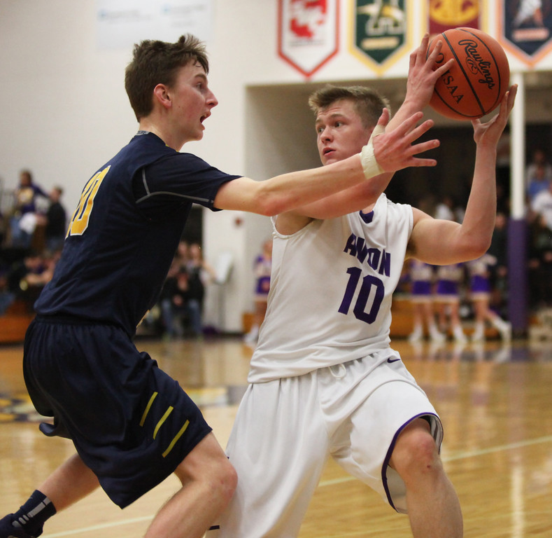 . Avon\'s jacob Chasteen is guarded closely near the sideline by Adam Skutt of Olmsted Falls during the second quarter. Randy Meyers -- The Morning Journal