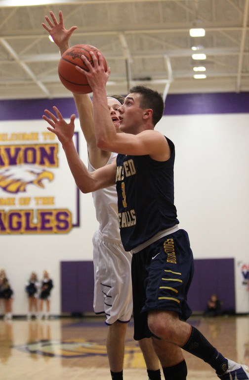 . Eric Hanna of Olmsted Falls drives past Dan Peganoff of Avon during the first quarter. Randy Meyers -- The Morning Journal