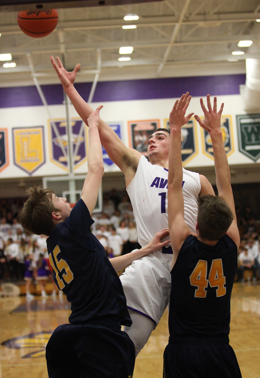 . Avon\'s Vlasi Pappas puts up a shot against Tommy Lloyd and Gavin Dietrich of Olmsted Falls during the second quarter. Randy Meyers -- The Morning Journal