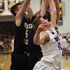 Avon's Jacob Chasteen and Dan Peganoff battle Gavin Dietruch and Tommy Lloyd of Olmsted Falls for a rebound during the second quarter. Randy Meyers -- The Morning Journal