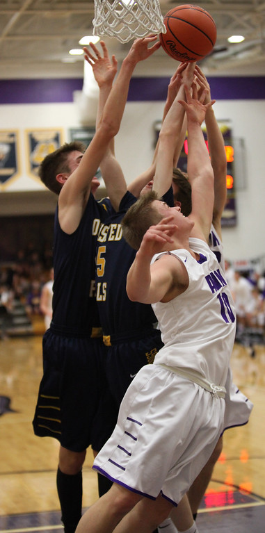 . Avon\'s Jacob Chasteen and Dan Peganoff battle Gavin Dietruch and Tommy Lloyd of Olmsted Falls for a rebound during the second quarter. Randy Meyers -- The Morning Journal