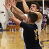 Avon's Ryan Bertrand shoots and scores over Josh Goodwin of Olmsted Falls during the second quarter. Randy Meyers -- The Morning Journal