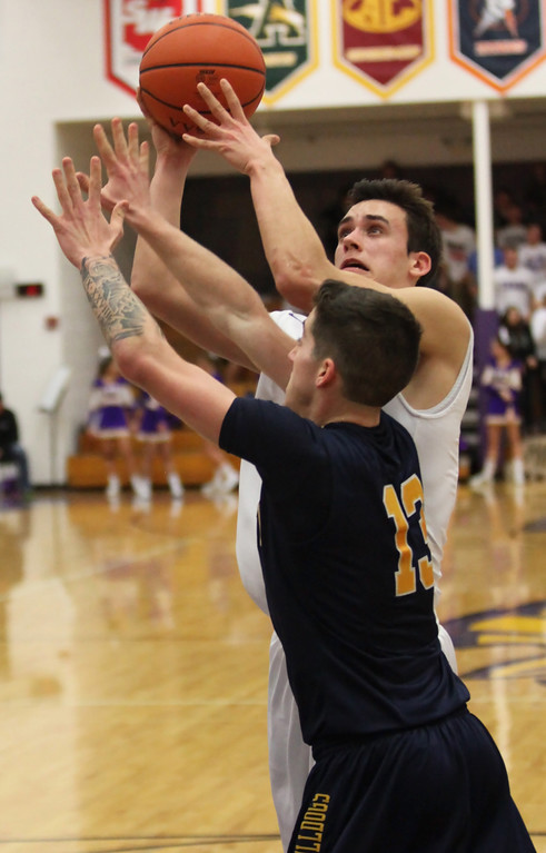 . Avon\'s Ryan Bertrand shoots and scores over Josh Goodwin of Olmsted Falls during the second quarter. Randy Meyers -- The Morning Journal