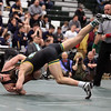 Sam Dover of St. Edward drives Kevin Kelly of North Olmsted to the mat during the 138lb championship match. Randy Meyers -- The Morning Journal