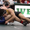 Larry Grapo of St. Edward defeats Trever Begin of Midview during the 152lb champoinship match. Randy Meyers -- The Morning Journal