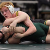 Alan Hart of St. Edward turns Liam Kruger of Westlake for the pin during the sectional championship in the 132-pound class. Randy Meyers -- The Morning Journal