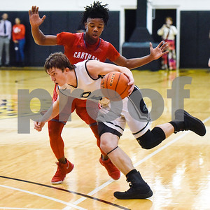 Canton junior guard McGwire Martin (5) dribbles the ball past Carthage senior guard Dee Bowens (2) during a high school basketball regional quarterfinal playoff game at Tyler Junior College in Tyler, Texas, on Tuesday, Feb. 27, 2018. The Carthage Bulldogs beat the Canton Eagles 57-42. (Chelsea Purgahn/Tyler Morning Telegraph)